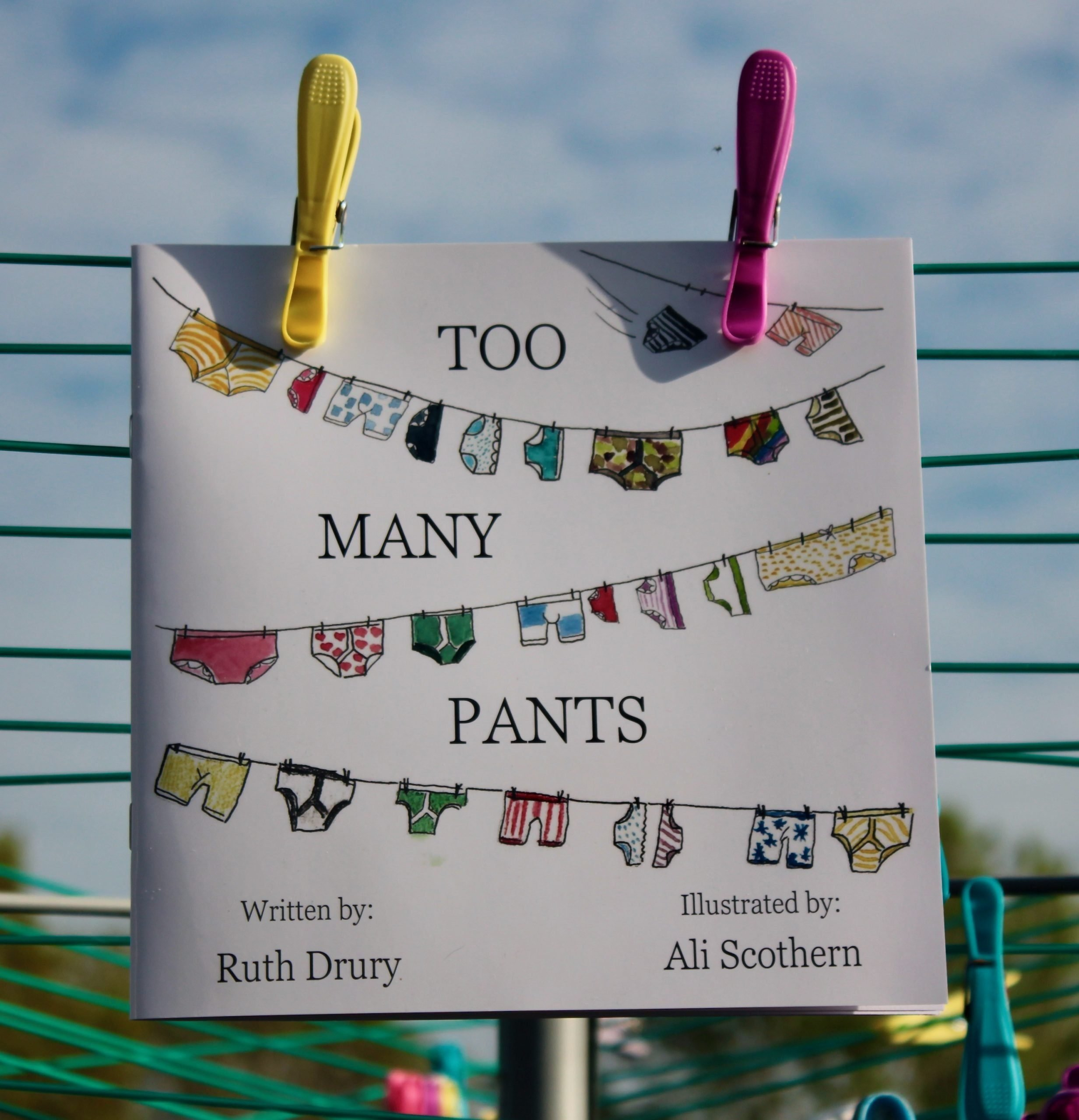 """Picture of """"Too Many Pants"""" book hangin g on a washing line."""
